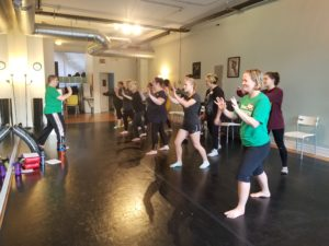 Image of moms & daughters practicing palm heel strikes